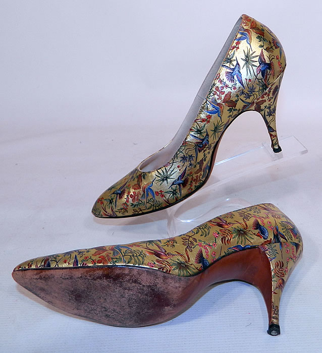 Vintage Galliano Gold Leather Botanical Hummingbird Print Stiletto Heel Shoes. The shoes measure 10 inches long, 3 inches wide, with 3 1/2 inch high heels and there is a size 7 1/2 M width stamped inside. They are in good condition and have been gently worn. These are truly a rare and wonderful piece of wearable shoe art!