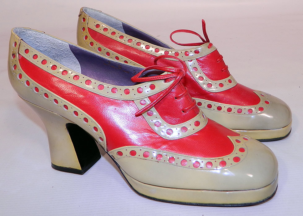 Unworn Vintage Jerry Edouard Joseph Red Eyelet Leather Oxford Platform Shoes & Box. They are made of a two tone red and ecru cream color leather with decorative eyelet punch work designs.