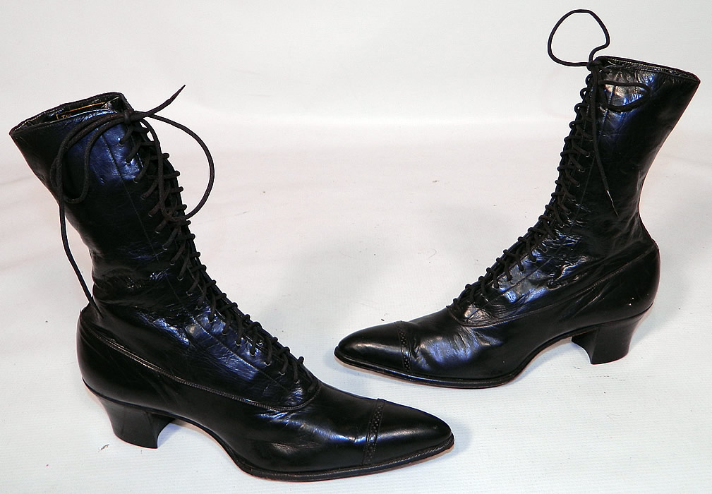 Vintage Poehlman Shoe Co Unworn Victorian Black Leather High Top Lace-up Boots. This pair of vintage Poehlman Shoe Co unworn Victorian era antique black leather high top lace-up boots dates from 1900. They are made of a supple black leather, with decorative punch work designs across the toes.