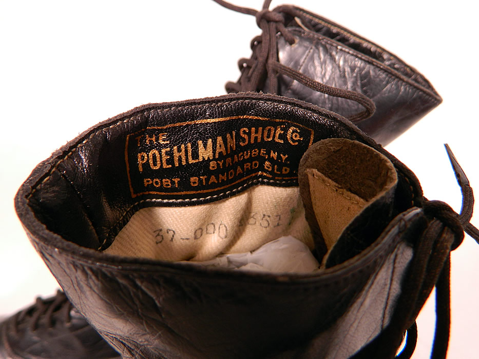 "Vintage Poehlman Shoe Co Unworn Victorian Black Leather High Top Lace-up Boots. They are stamped inside ""The Poehlman Shoe Co. Syracuse, N.Y."" and on the bottom soles ""John Gray"". The boots measure 9 inches tall, 10 1/2 inches long, 2 1/2 inches wide, with 2 inch high heels."