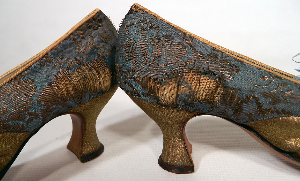 Edwardian Titanic Blue Silk Gold Lamé Damask Brocade Feather Trim Shoes. They have been gently worn and are in as-is fair condition, with several frayed splits on the blue silk brocade fabric back side heels and some molting missing feathers (see close-up).