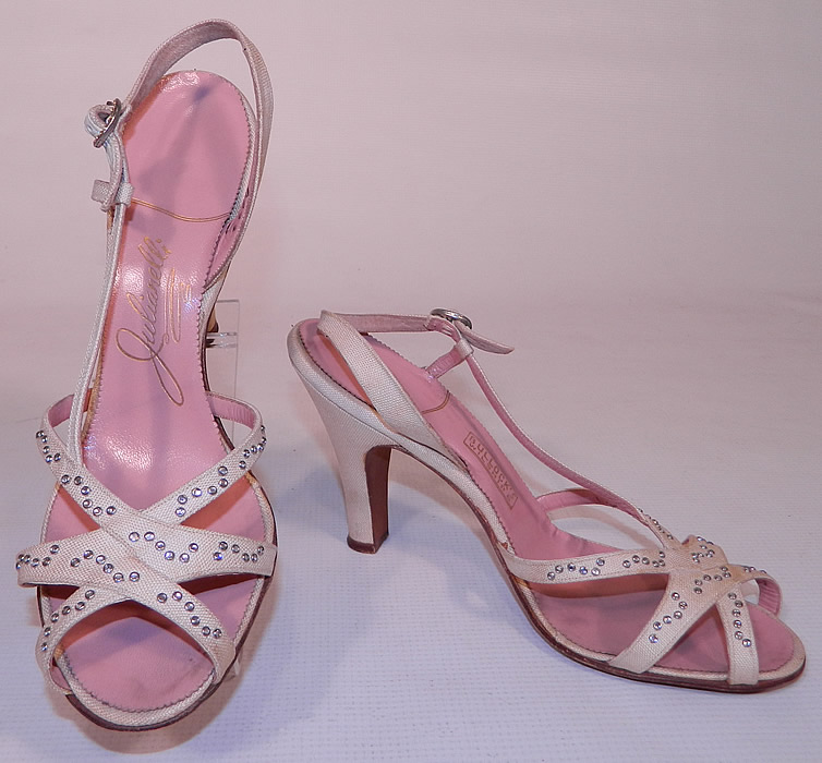 Vintage Julianelli White Linen Rhinestone Strap Sling Back Sandal Shoes. These stunning summer sandal style shoes have open toes, with crisscrossing straps on the vamps, an adjustable rhinestone buckle sling back strap and linen covered modified boulevard heel.