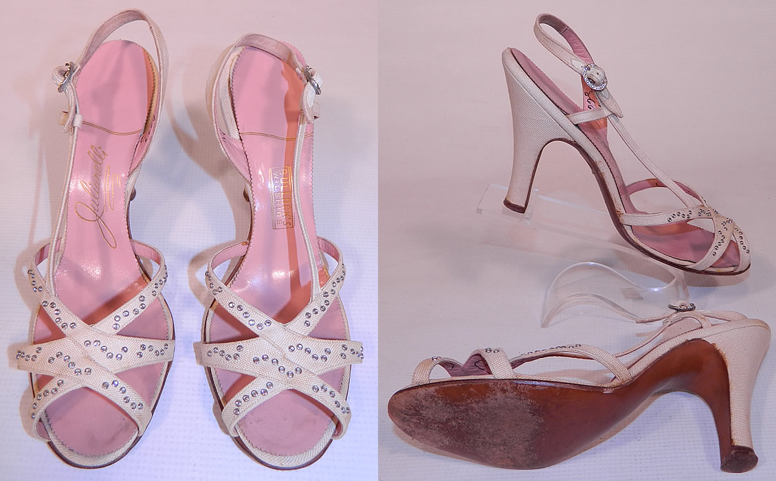 Vintage Julianelli White Linen Rhinestone Strap Sling Back Sandal Shoes. The shoes measure 9 1/2 inches long, 3 inches wide, with 3 1/2 inch high heels. They have been gently worn, with only minor wear. These are truly a wonderful piece of quality made wearable shoe art!