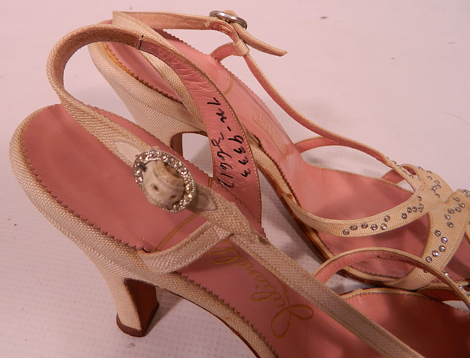 "Vintage Julianelli White Linen Rhinestone Strap Sling Back Sandal Shoes. They have a pink insole lining with a gold embossed label inside ""Julianelli"", ""Bullock's Wilshire"" and are stamped a size 7 N."