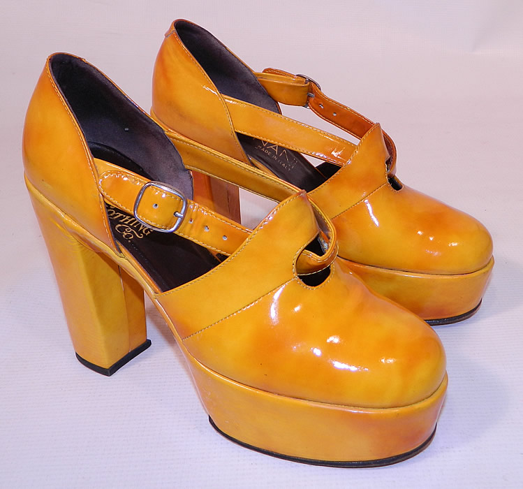 Vintage Mignani Right Bank Clothing Yellow Patent Leather  Platform Shoes. This pair of vintage Mignani Right Bank Clothing yellow patent leather platform shoes date from the 1970s. The shoes measure 9 1/2 inches long, 3 inches wide, with 4 1/2 inch high heels.
