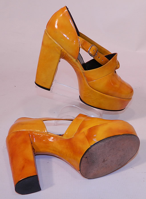 Vintage Mignani Right Bank Clothing Yellow Patent Leather  Platform Shoes. These fabulous funky shoes have a platform front lift style, with rounded toes, chunky high heels and side buckle adjustable twist straps.