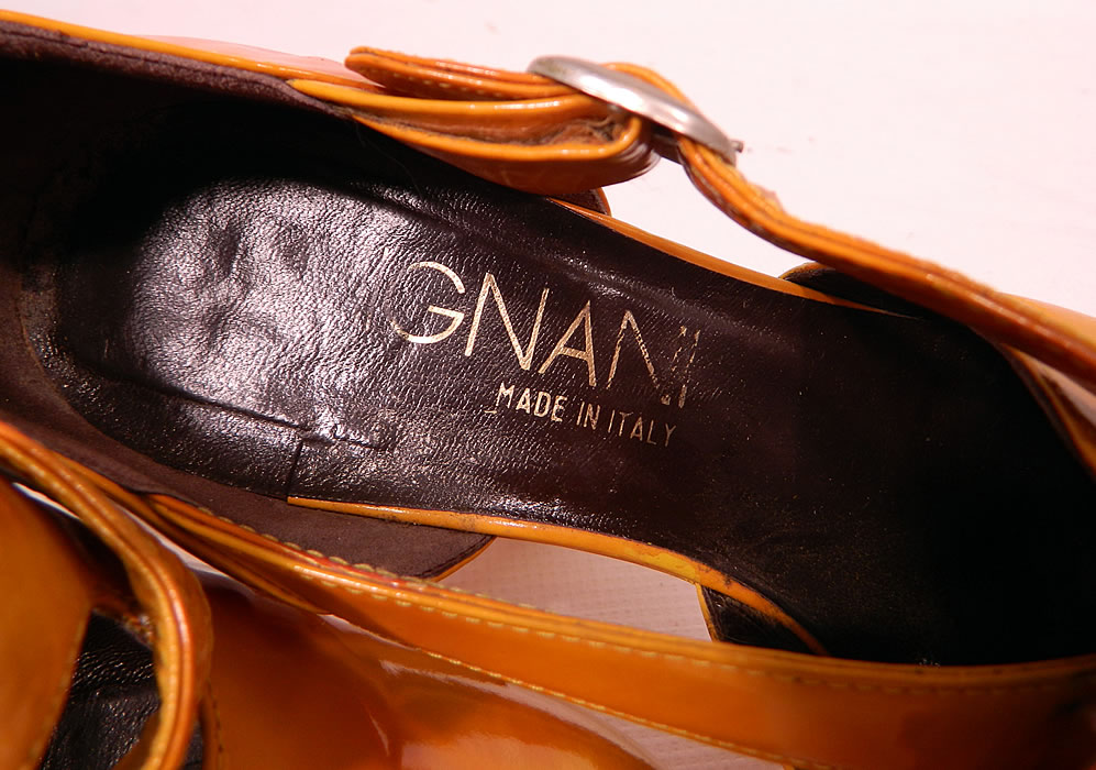 "Vintage Mignani Right Bank Clothing Yellow Patent Leather  Platform Shoes. There is gold embossed lettering a ""Mignani Made in Italy"" designer label in one shoe and ""The Right Bank Clothing Co."" store label stamped inside the other shoe."