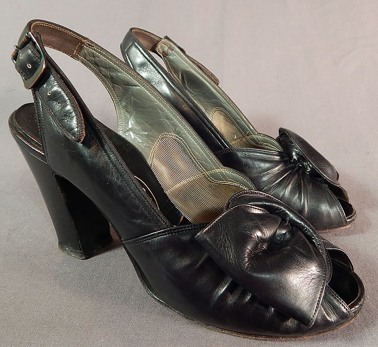 Vintage I. Miller Black Patent Leather Sling Back Peep Toe Pumps Pinup ShoesThis pair of vintage I. Miller black patent leather sling back peep toe pumps pinup shoes date from the 1940s.
