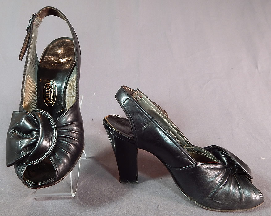 Vintage I. Miller Black Patent Leather Sling Back Peep Toe Pumps Pinup ShoesThey have been gently worn and are in good condition. These are truly a wonderful piece of quality made wearable shoe art!