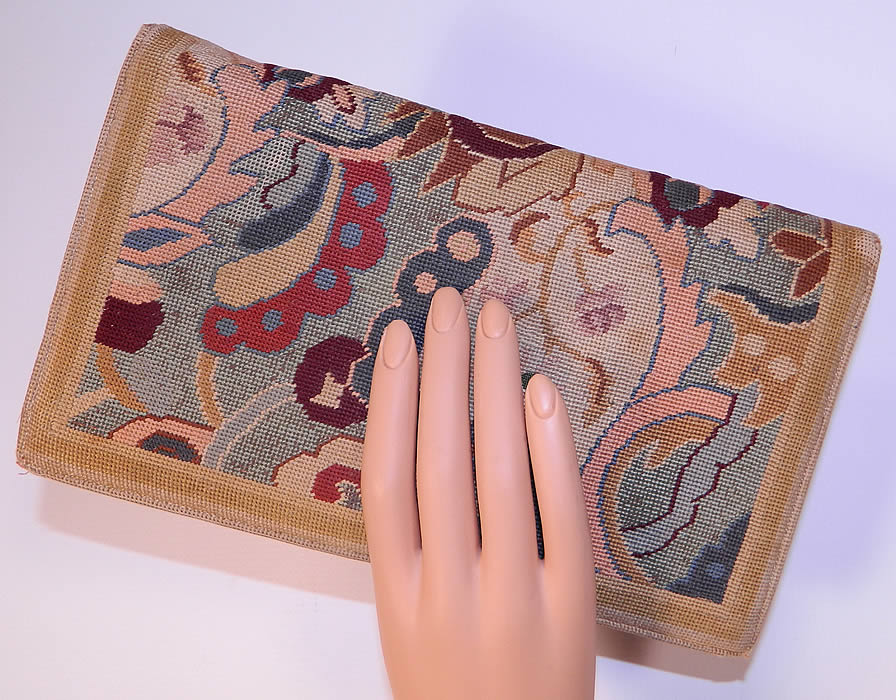 Vintage Art & Crafts Floral Petit Point Needlepoint Embroidered Clutch Bag Purse. The purse measures 9 1/2 inches long and 5 1/2 inches wide. It is in good condition, with only some slight wear on the corners.