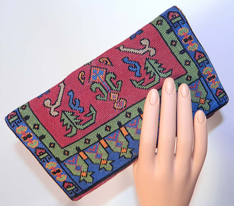 Vintage Oriental Rug Petit Point Needlepoint Embroidered Clutch Bag Purse. This pretty purse has a clutch envelope style, with a fold over flap snap closure, silk lined with an inside zipper pocket, mirror and attached coin purses.
