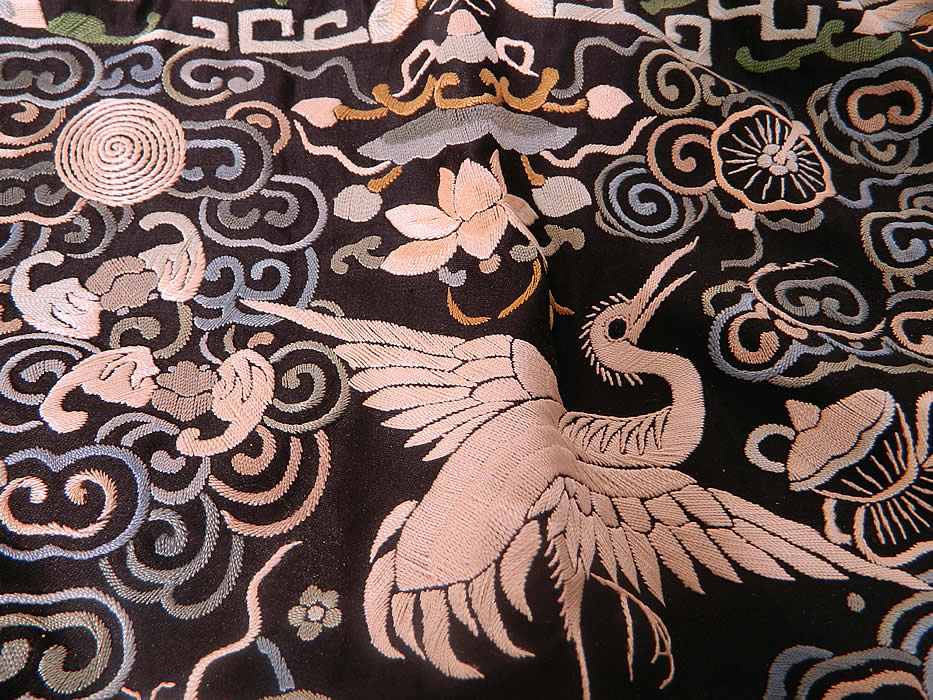 Antique Chinese Silk Embroidered Crane Bird First Rank Badge Tassel Trim. There is a white crane bird in the center, with the Eight Buddhist symbols of good fortune, bats, butterflies and waves of water along the bottom.