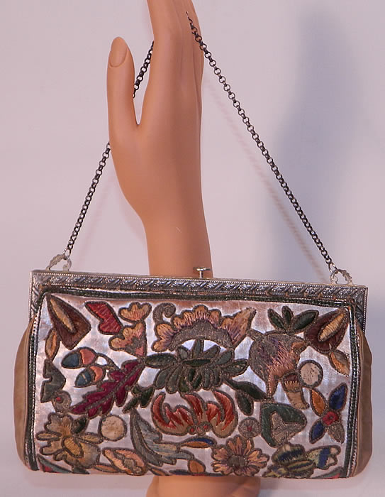 Vintage Art Deco Floral Stumpwork Embroidered Silver Leather Evening Purse. The purse measures 9 inches long and 5 inches wide.