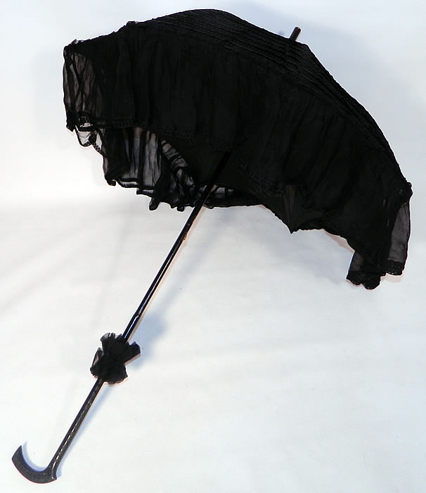 Edwardian Black Silk Zigzag Stitched Carved Ebony Handle Parasol. This pretty parasol umbrella has a pagoda dome shape with metal frame and is fully lined inside. The parasol measures 38 inches long and 80 inches in circumference when opened.