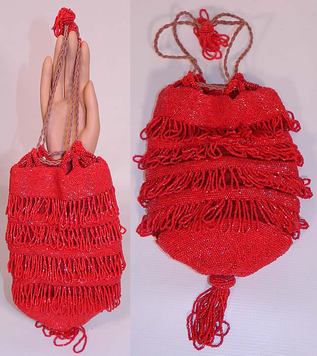 Antique Art Deco Red Beaded Loop Fringe Tassel Drawstring Flapper Purse.  This antique Art Deco red beaded loop fringe tassel drawstring flapper purse dates from the roaring 1920s. It is hand beaded with bright radiant red beads done in a loop fringe layered design. There is a red beaded fringe tassel trim hanging down from the bottom and off the top straps.