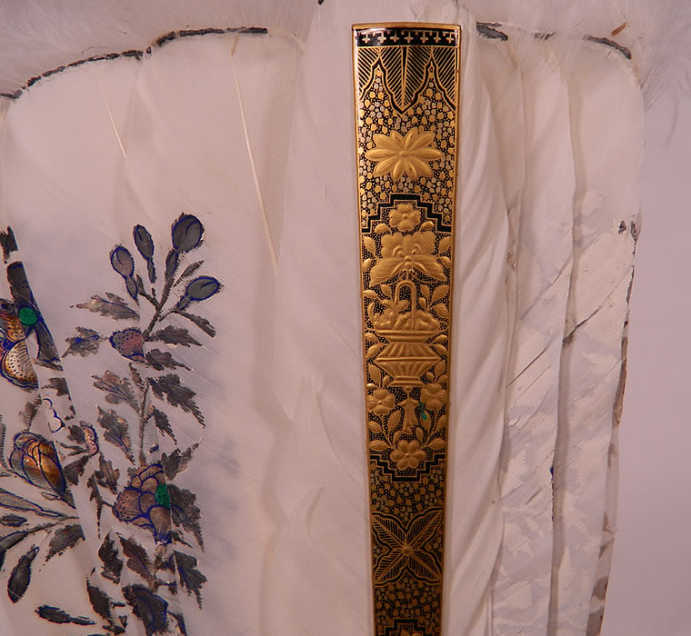 Antique Chinese Hand Painted Silver Leaf Feathers Gold Lacquer Fan & Box. The fan measures 12 inches long and 24 inches wide when opened. It is in good condition, with a few small frays breaks along the painted feathers