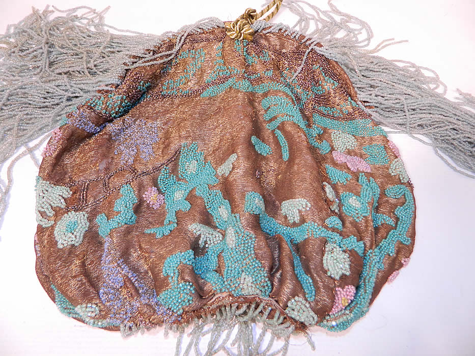 Antique Art Deco Gold Lamé Pastel Beaded Flapper Dress Fabric Fringed Purse. The purse measures 12 inches long, 21 inches long with the added beaded fringe trim and is 10 inches wide.