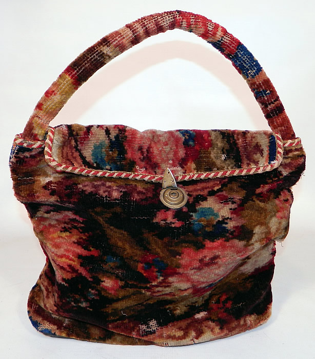 Victorian Antique Civil War Era Document Wool Mohair Carpet Bag Purse. This antique Victorian Civil War era document wool mohair carpet bag purse dates from the 1860s. It is hand stitched, made of a colorful floral pattern design wool mohair fabric, with red and white braided rope trim edging.