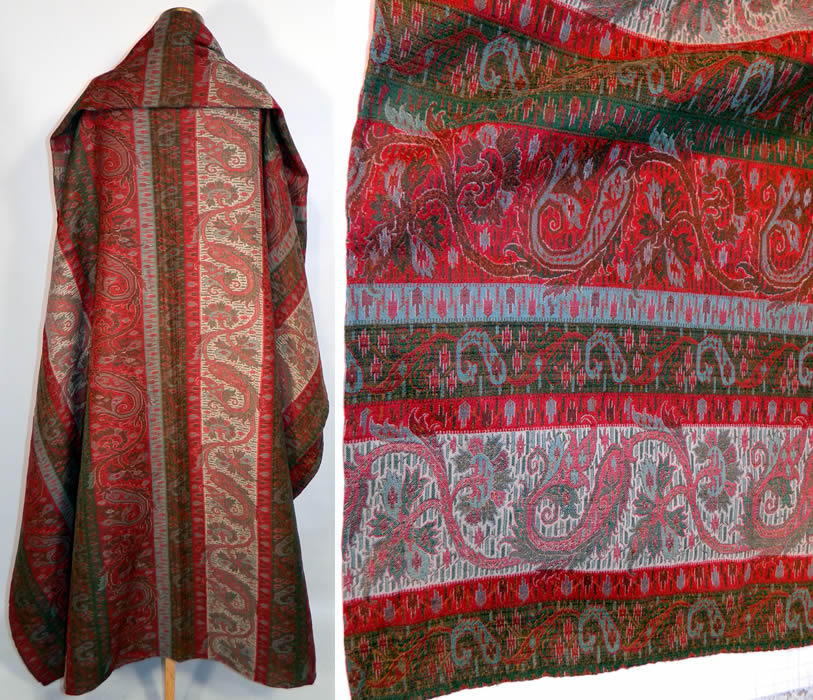 Victorian Antique Jacquard Hand Loom Wool Paisley Striped Shawl Banquet Size. These paisley shawls were made in Kashmir, Persia, India and Europe in Scotland at Paisley itself. This stunning shawl has wonderful workmanship and detail with a colorful striped floral leaf, boteh tear drop shape design and green selvage along the side edgings.