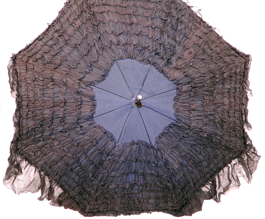 Edwardian Black Silk Ruched Ebony Amethyst Jeweled Handle Parasol. This pretty parasol umbrella has a pagoda dome shape with metal frame and is fully lined inside in black silk. The parasol measures 36 inches long and 88 inches in circumference when opened.