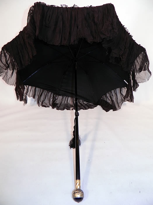 Edwardian Black Silk Ruched Ebony Amethyst Jeweled Handle Parasol. It is in good  condition, with only the fabric loose on one spoke tip needing attaching and some fraying along the bottom silk ruffle trim. This is truly a wonderful antique bejeweled elegant parasol!