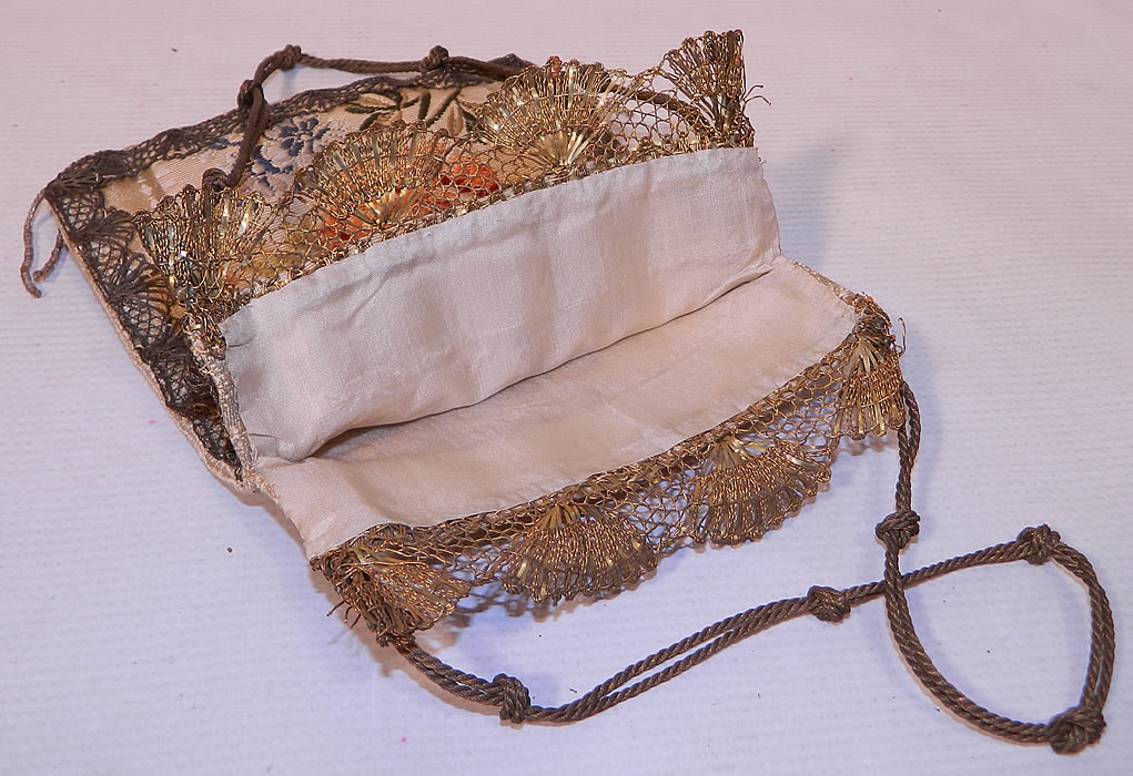 Antique 18th Century French Silk Damask Brocade Fabric Gold Lace Purse. This pretty purse has a square pouch bag style with an open top and no closure. The purse measures 7 1/2 inches long and 6 inches wide. It is in good condition. This is truly an amazing piece of an early antique textile art!