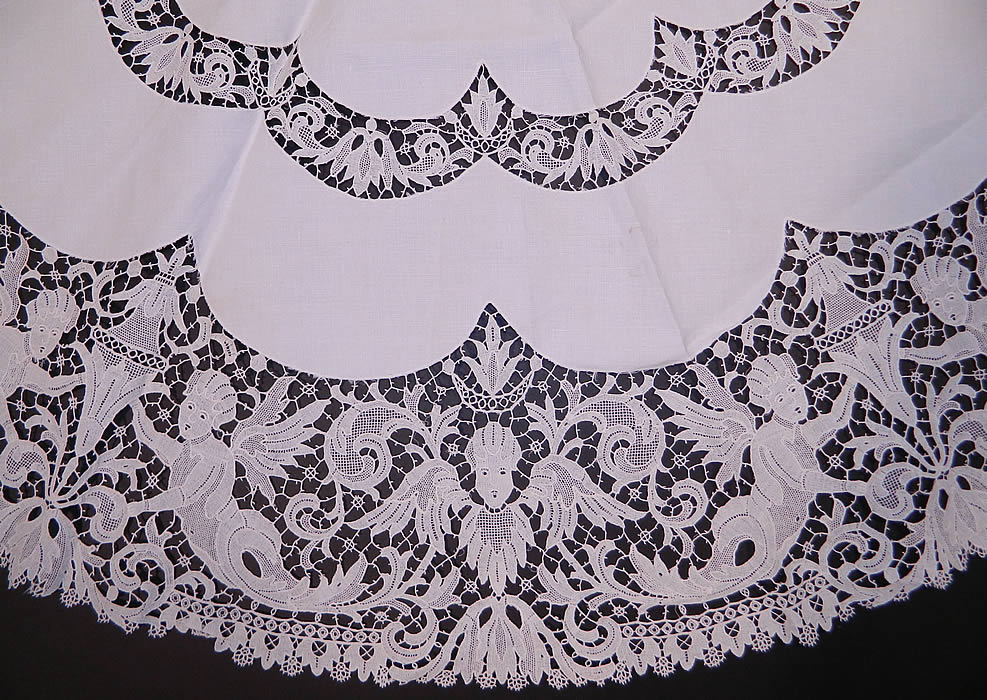 Victorian Antique Point de Venise Lace Renaissance Cupid Linen Round Tablecloth. There is a decorative Renaissance inspired allegorical design with cupid angels and urns done in lace.