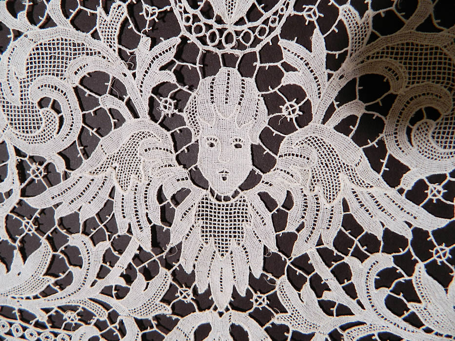 Victorian Antique Point de Venise Lace Renaissance Cupid Linen Round Tablecloth. This lovely lace round tablecloth table cover measures 45 inches wide and is 143 inches in circumference.