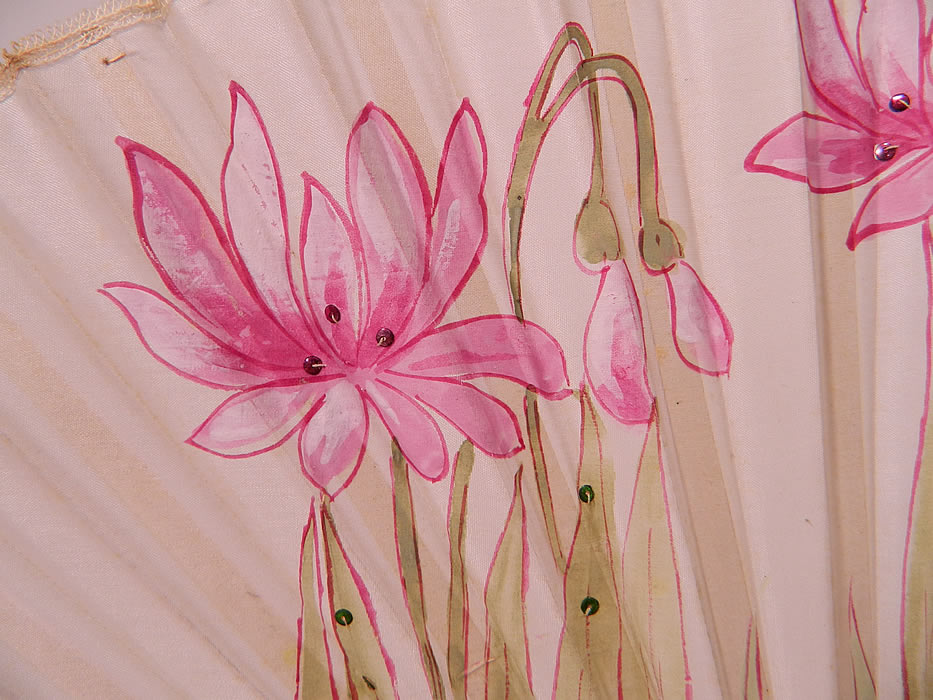 Art Nouveau Japonism Hand Painted Flower Sequin Silk Pleated Folding Fan. It is made of a pleated white silk fabric, white wooden sticks, guards, pink hand painted Japanese art style flowers and tiny pink, green sequin accents.
