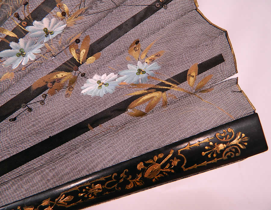 Antique Victorian Hand Painted Flowers Birds Sequin Black Silk Pleated Folding Fan. It is in as-is fair condition, with tiny frays along the top silk fabric (see close-up). This is truly a wonderful piece of hand painted fan art!