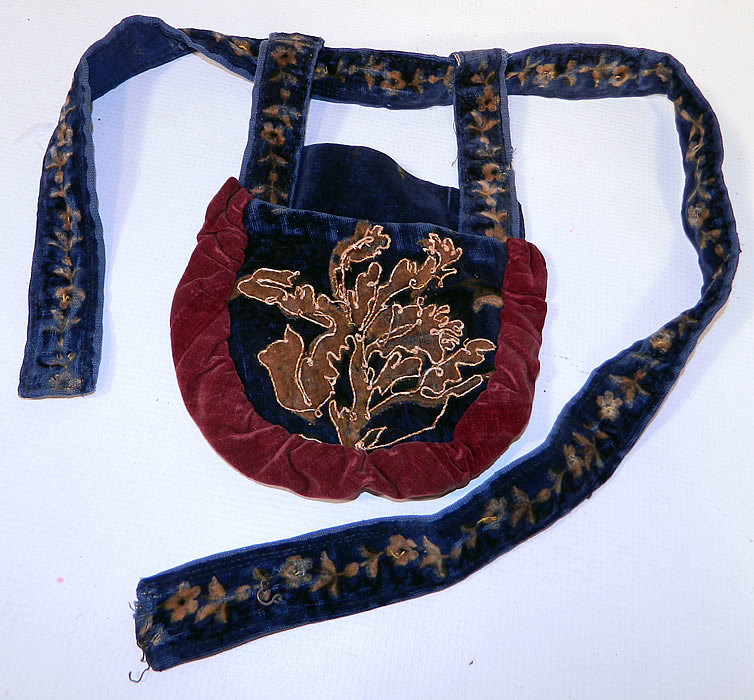 Victorian Antique Printed Velvet Soutache Embroidered Belted Pouch Purse. This Victorian era antique printed velvet soutache embroidered belted pouch purse dates from 1870. It is made of a printed blue velvet fabric, with a decorative floral design pattern outlined on the front with raised soutache embroidery work and red velvet ruched gathering trim edging.
