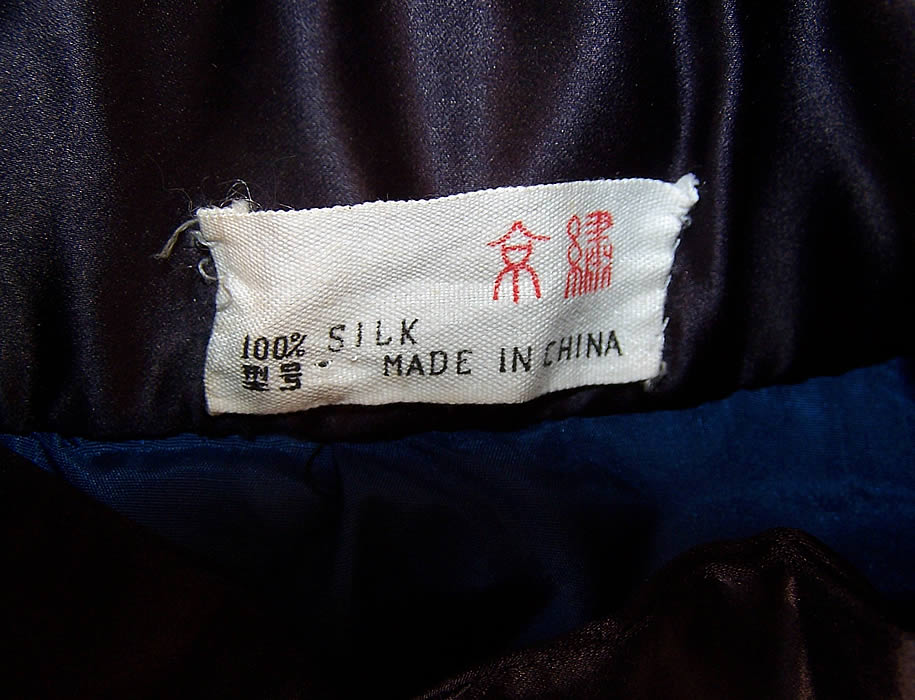 Vintage Chinese Dragon Embroidered Roundel Black Silk Robe Coat label close up.