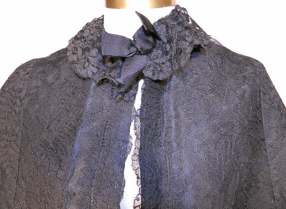 Victorian Black Chantilly Lace Mourning Mantle Cape Dolman Capelet. . This magnificent mourning mantle dolman style cape capelet has a black lace silk ribbon bow trim ruffle collar, a fitted back bottom skirt drape, hooks for closure down the front and is fully lined in a black silk taffeta fabric inside.
