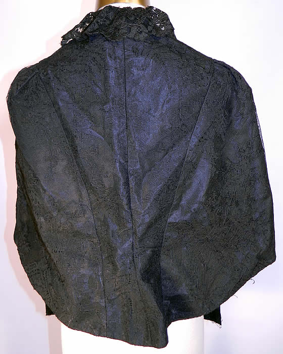 Victorian Black Chantilly Lace Mourning Mantle Cape Dolman Capelet. The cape measures 22 inches long in the front, 19 inches long in the back, with a 34 inch bust and 15 inches across the shoulders.