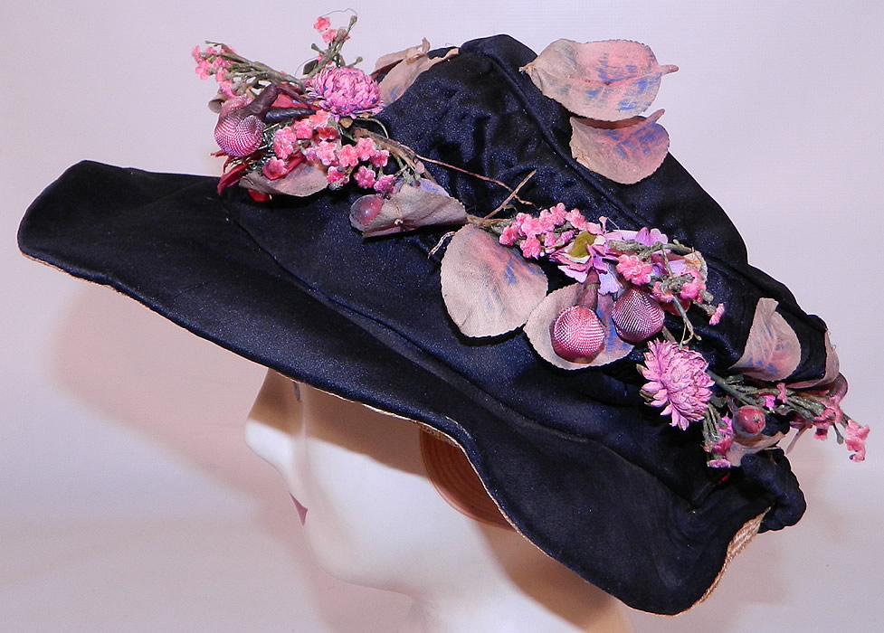 Edwardian Black Silk & Natural Straw Floral Garland Trim Wide Brim Hat. This beautiful hat has an uneven wavy brim, wider in the front, narrow in back and slouched soft round crown top.