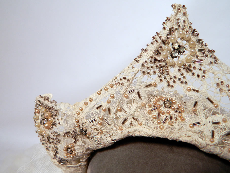 Antique Brussels Bobbin Lace Beaded Tiara Crown Headpiece Net Wedding Veil. The headpiece is made of wire and covered with an off white Brussels Duchesse bobbin lace with inserts of Point de Gaze Rose Point needle lace.