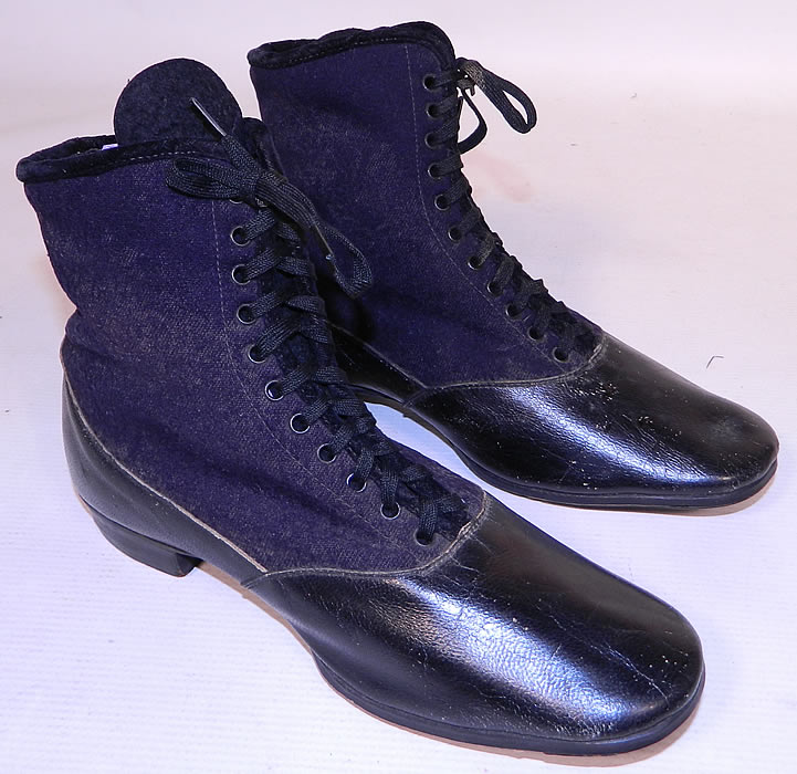 Victorian Black Leather Navy Blue Wool Winter High Top Lace-up Boots . They are made of a navy blue wool fabric top, with a black patent leather bottom shoe.