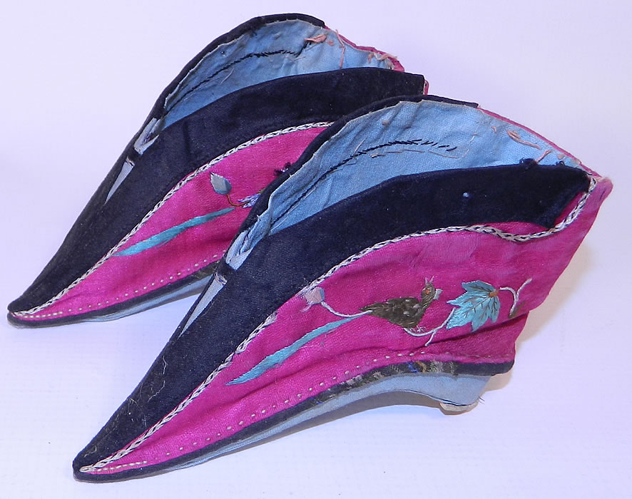 Antique Chinese Silk Embroidered Mantis & Bird Bound Foot Lotus Slipper Shoes. This antique Chinese silk embroidered mantis and bird bound foot lotus slipper shoes date from the early 1900s. They are hand stitched and made of a purplish red pink fuchsia color silk fabric, with colorful raised padded satin stitch embroidery work of a phoenix bird on one side and a praying mantis insect on the other side.