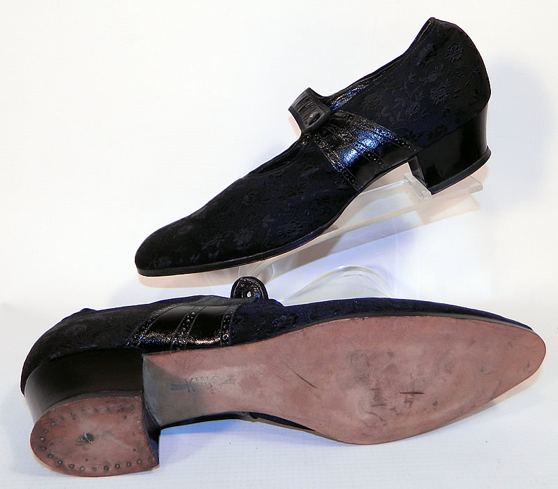 Unworn Vintage Black Silk Brocade Patent Leather Mary Jane Button Strap Shoes. These womens shoes have a button strap closure on the instep vamps and black stacked wooden cube heels.