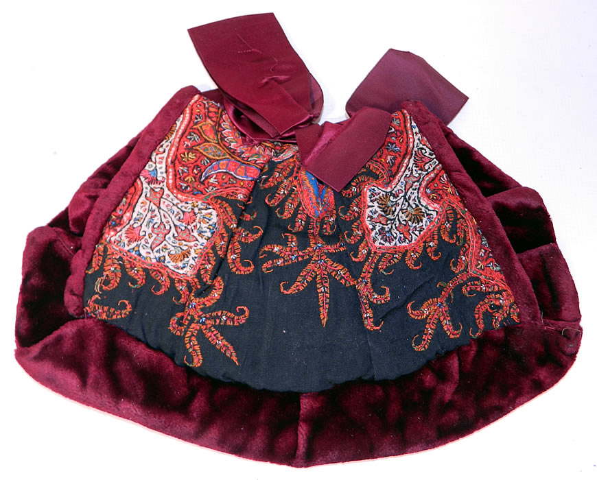 Antique Kashmir Hand Embroidered Woven Wool  Paisley Velvet Winter Muff. It is made of colorful soft Kashmir wool hand embroidered and pieced together in a paisley pine cone shaped tear drop motif boteh and decorative floral leaf designs, with a dark red burgundy color plush velvet fabric.