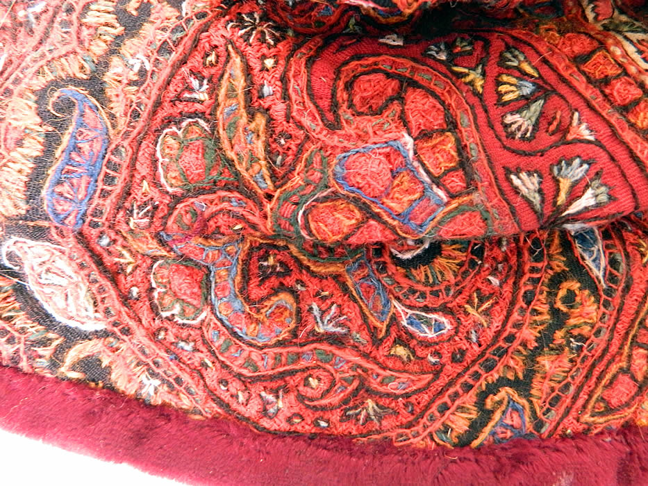 Antique Kashmir Hand Embroidered Woven Wool  Paisley Velvet Winter Muff. The muff measures 13 by 9 inches. It is in good condition. This is truly an exceptional unique one of a kind piece of  textile art!